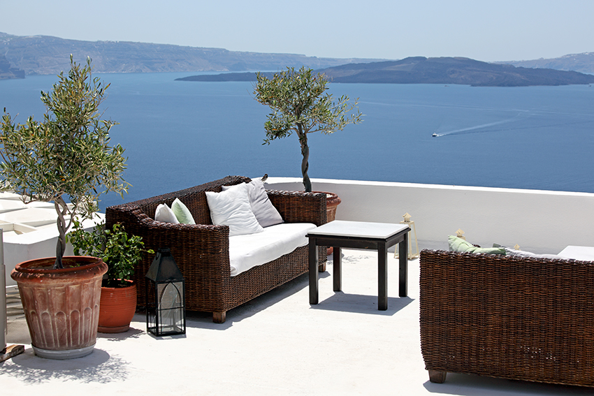 Terrace overlooking sea, Oia Village, Santorini, Cyclades, Greece.